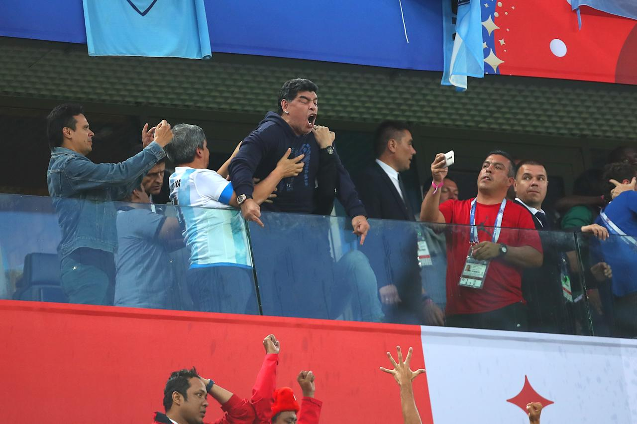 <p>Argentina legend Diego Maradona celebrates after Marcos Rojo of Argentina scored a goal to make it 1-2 during the 2018 FIFA World Cup Russia group D match between Nigeria and Argentina at Saint Petersburg Stadium on June 26, 2018 in Saint Petersburg, Russia. (Photo by Robbie Jay Barratt – AMA/Getty Images) </p>