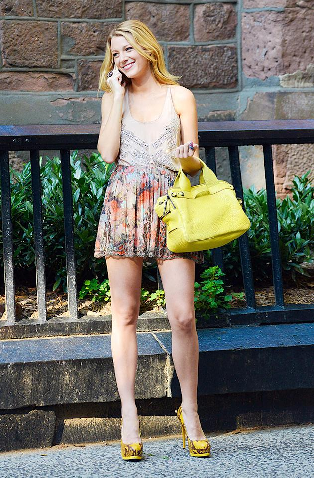 "Blake Lively's sparkly tank and Haute Hippie floral print skirt are super cute, but the standouts in this photo are the ""Gossip Girl"" star's accessories: a $700, lemony-yellow Phillip Lim ""Lark"" bag and Pour La Victoire snakeskin pumps. Boho-chic has never looked better! (8/2/2012) Follow 2 Hot 2 Handle creator, Matt Whitfield, on Twitter!"