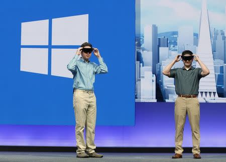 Students from Case Western Reserve University don the new HoloLens during the keynote address during the Microsoft Build 2016 Developers Conference in San Francisco, California March 30, 2016. REUTERS/Beck Diefenbach/File Photo