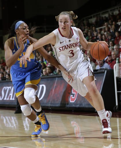 Stanford's Mikaela Ruef (3) dribbles next to UCLA's Atonye Nyingifa (11) during the first half of an NCAA college basketball game in Stanford, Calif., Friday, Jan. 18, 2013. (AP Photo/Marcio Jose Sanchez)