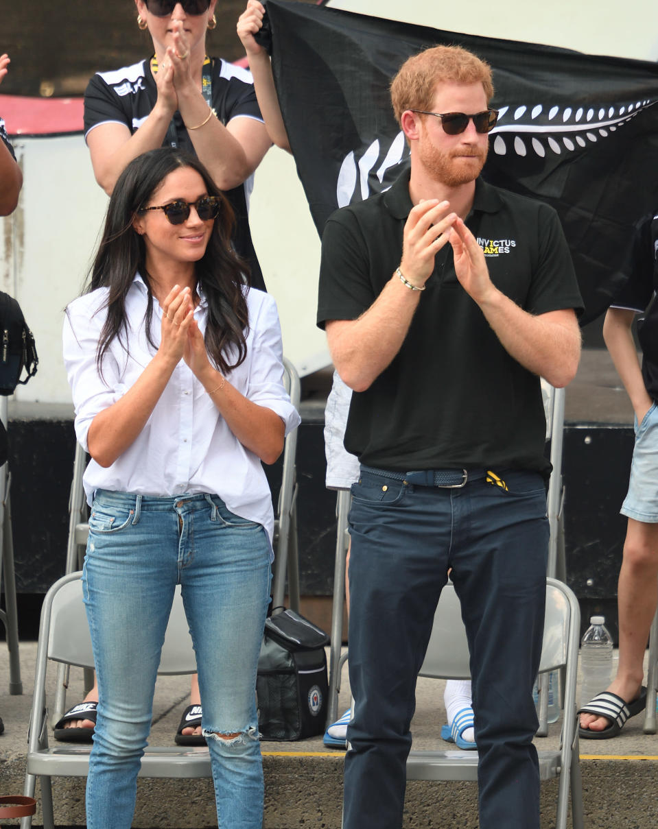 Markle was spotted in white during her and Prince Harry's first public appearance as a couple at the Invictus Games 2017 in Toronto, Canada. She paired the casual button-down top with ripped blue jeans. (Photo: Getty Images)