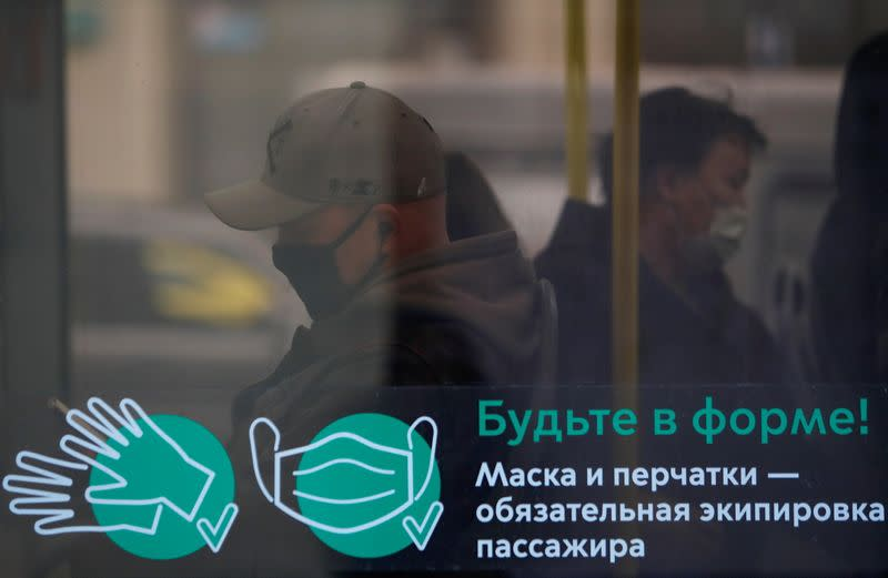 Passengers wear protective face masks in a bus amid the outbreak of the coronavirus disease in Moscow
