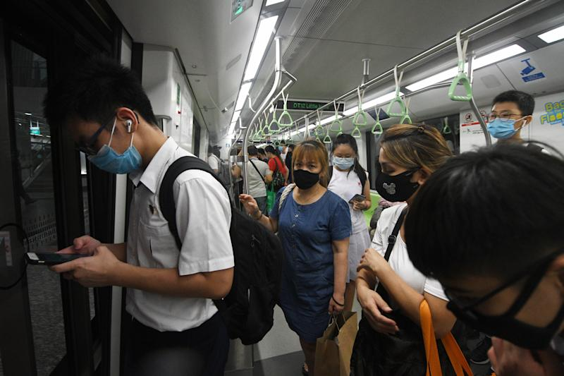 """SINGAPORE, June 3, 2020 -- People take the train on the downtown line in Singapore on June 3, 2020. Singapore enters the second day of post lockdown as the state embarked on a phased reopening from a COVID-19 """"circuit breaker"""" period to curb the spread of the coronavirus. (Photo by Then Chih Wey/Xinhua via Getty) (Xinhua/ via Getty Images)"""