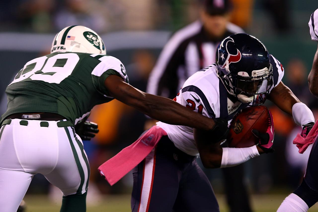 EAST RUTHERFORD, NJ - OCTOBER 08:  Brice McCain #21 of the Houston Texans intercepts a pass in the second quarter in front of Jason Hill #89 of the New York Jets at MetLife Stadium on October 8, 2012 in East Rutherford, New Jersey.  (Photo by Elsa/Getty Images)