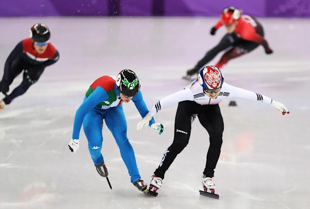 Arianna Fontana of Italy and Choi Min-jeong of South Korea race for the finish line during the short track speed skating women's 500-meter final at the PyeongChang 2018 Winter Olympics. (Getty Images)