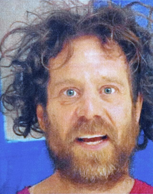 Kevin Neal, seen in a recent booking photo, had a history of domestic violence calls and a protective order against him by two female neighbors at the time of Tuesday's attack.