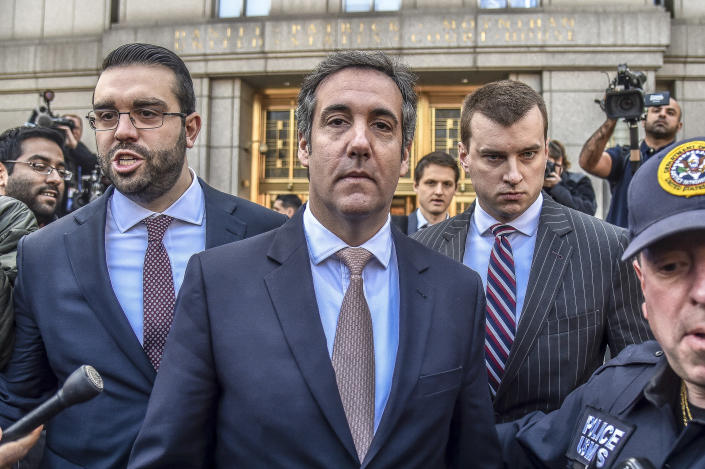 President Trump's personal lawyer, Michael Cohen, center, leaves a courthouse in New York on April 26, 2018. (Photo: Hector Retamal/AFP/Getty Images)