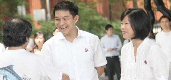 PAP new candidates Tan Chuan Jin and Sim Ann mingle with the crowd before the rally starts. (Yahoo! photo/Kzan)