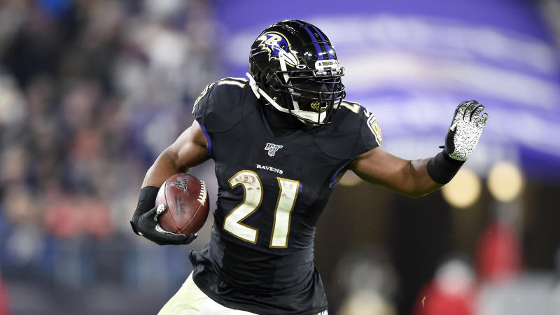 Baltimore Ravens running back Mark Ingram II runs with the ball against the New England Patriots during the second half of an NFL football game, Sunday, Nov. 3, 2019, in Baltimore. (AP Photo/Gail Burton)
