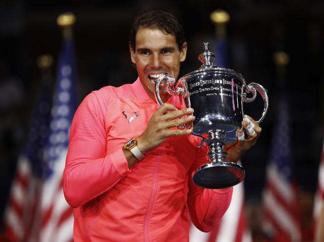 FILE - In this Sept. 10, 2017, file photo, Rafael Nadal, of Spain, holds up the championship trophy after beating Kevin Anderson, of South Africa, in the men's singles final of the U.S. Open tennis tournament in New York. Nadal, a French Open champion yet again a week past his 32nd birthday seems to stay forever young. (AP Photo/Julio Cortez, File)