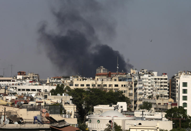 Black columns of smoke rise from heavy shelling in the Jobar neighborhood, east of Damascus, Syria, Sunday, Aug. 25, 2013. Syria reached an agreement with the United Nations on Sunday to allow a U.N. team of experts to visit the site of alleged chemical weapons attacks last week outside Damascus, state media said. (AP Photo/Hassan Ammar)