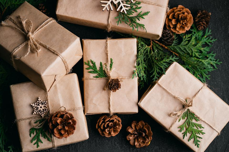 Christmas, New Year, winter holidays concept and celebration mood. Festive decorated gift boxes on dark background
