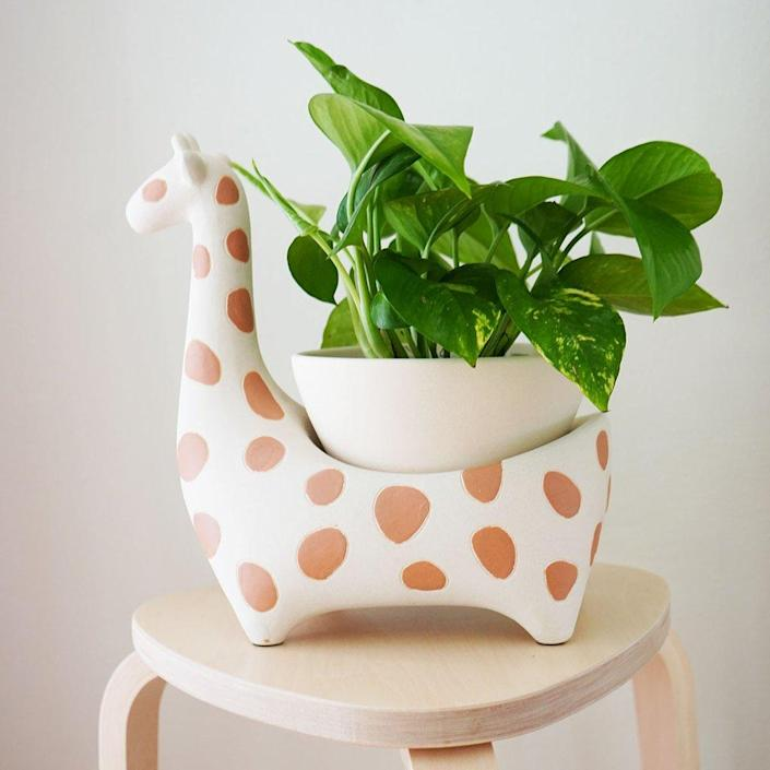 """This giraffe pot is half decoration, half practical plant planter, and wholly unique and adorable. We dare you not to add to cart. $79, Jungalow. <a href=""""https://www.jungalow.com/collections/live-plants-planters/products/giraffee-savannah-garden-pot-by-justina-blakeney"""" rel=""""nofollow noopener"""" target=""""_blank"""" data-ylk=""""slk:Get it now!"""" class=""""link rapid-noclick-resp"""">Get it now!</a>"""