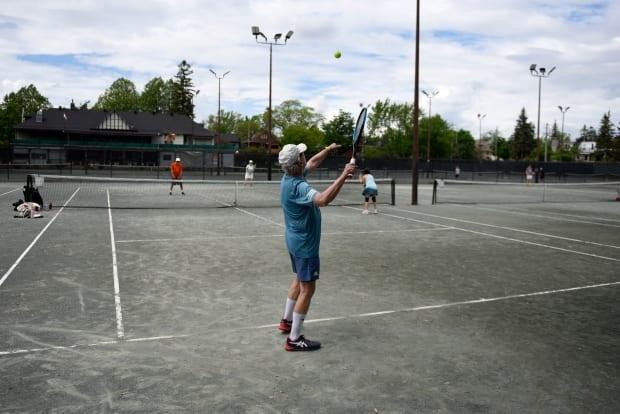 People play doubles tennis at the Ottawa Tennis and Lawn Bowling Club on Saturday, May 22, 2021, as tennis courts and other outdoor recreation facilities reopen across the province. (Justin Tang/Canadian Press - image credit)
