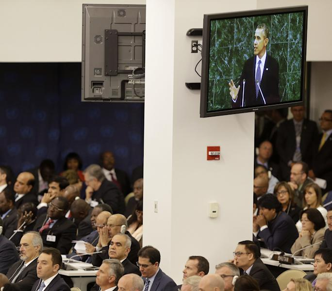 Diplomats, including Syrian Ambassador to the United Nations Bashar Ja'afari, bottom left, listen as U.S. President Barack Obama speaks about Syria during the 68th session of the General Assembly at United Nations headquarters in New York, Tuesday, Sept. 24, 2013. (AP Photo/Seth Wenig)
