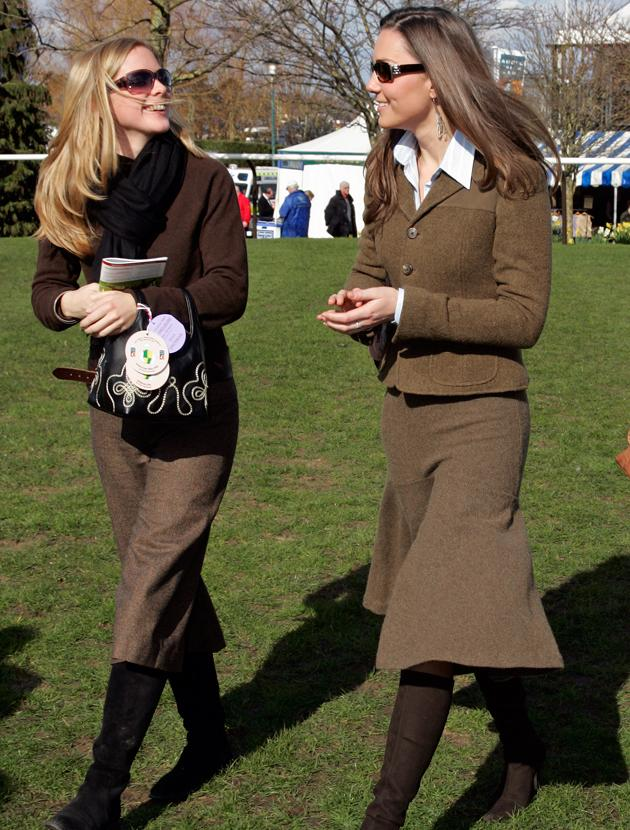 Kate Middleton photos: Oh dear, can we really class this as a fashion hit? Brown, cut on the bias with semi-matching jacket – where do we start. We can't be mean to Kate so we'll just be thankful her style has evolved over the years.