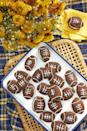 """<p>Your game day guests will adore these whoopie pies that are filled with delicious cinnamon cream.</p><p><strong><a href=""""https://www.countryliving.com/food-drinks/a24276425/football-whoopie-pies-with-cinnamon-cream/"""" rel=""""nofollow noopener"""" target=""""_blank"""" data-ylk=""""slk:Get the recipe"""" class=""""link rapid-noclick-resp"""">Get the recipe</a>.</strong></p><p><strong><strong><strong><a class=""""link rapid-noclick-resp"""" href=""""https://www.amazon.com/Hamilton-Beach-62682RZ-Mixer-Snap/dp/B001CH0ZLE/?tag=syn-yahoo-20&ascsubtag=%5Bartid%7C10050.g.5080%5Bsrc%7Cyahoo-us"""" rel=""""nofollow noopener"""" target=""""_blank"""" data-ylk=""""slk:SHOP HAND MIXERS"""">SHOP HAND MIXERS</a></strong></strong></strong></p>"""