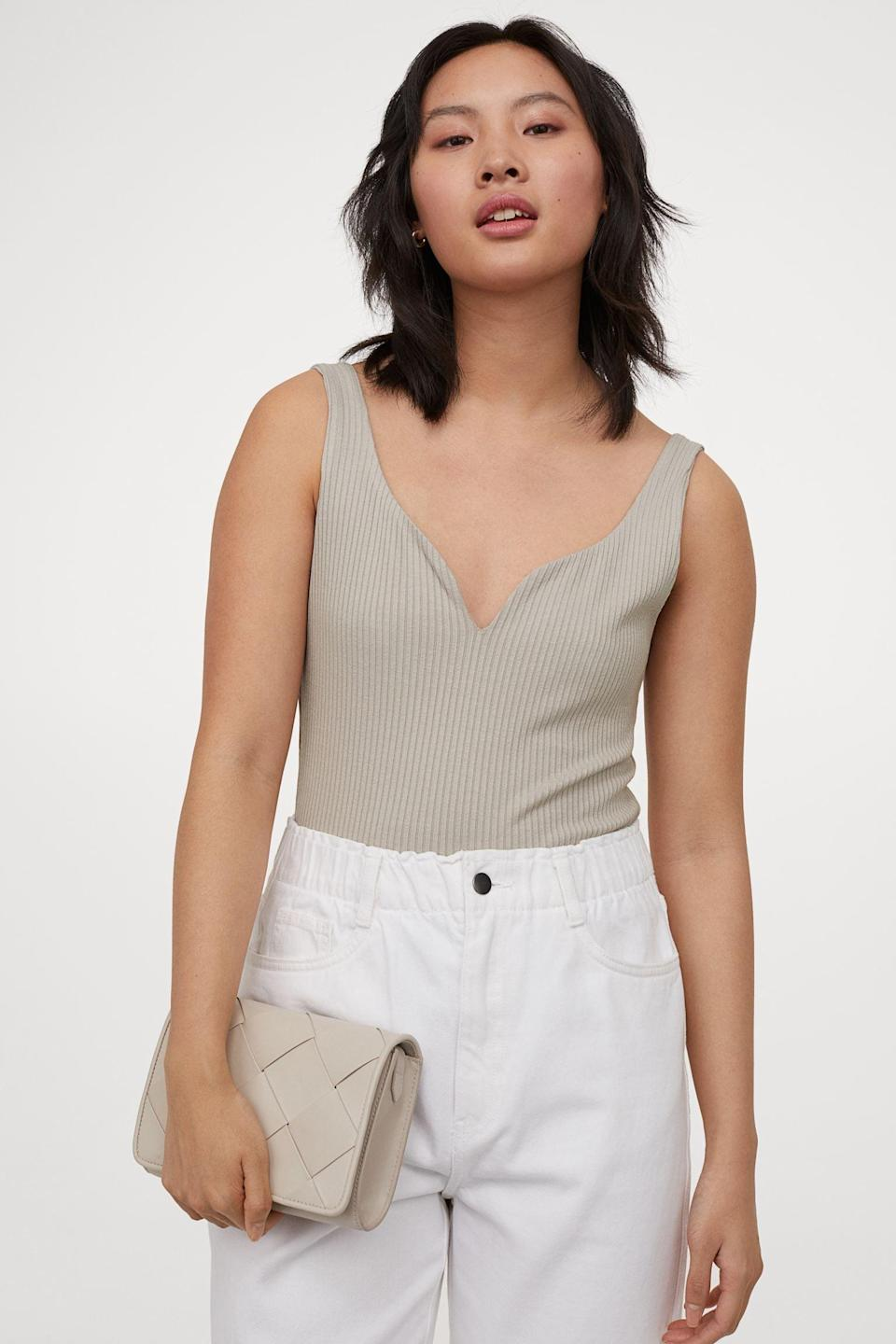 <p>The neckline of this <span>Ribbed Tank Top</span> ($25) is both unexpected and attractive.</p>