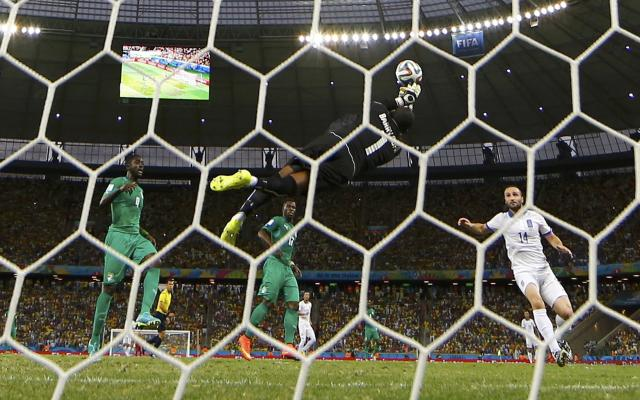 Ivory Coast's goalkeeper Barry makes a save during their 2014 World Cup Group C soccer match against Greece at the Castelao arena in Fortaleza