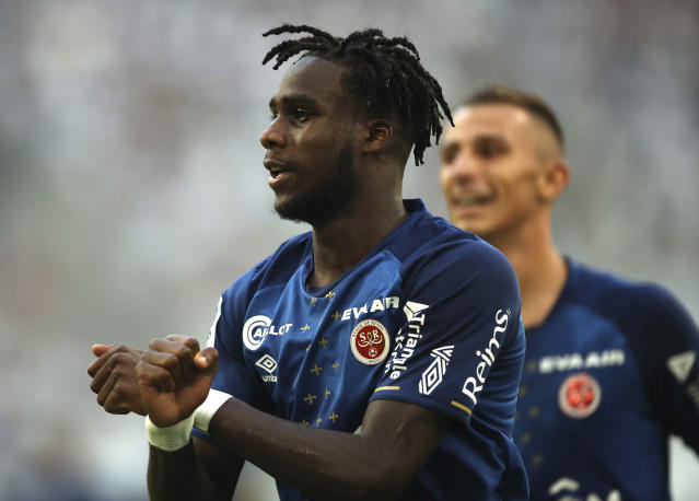 Reims' Boulaye Dia celebrates after scoring the opening goal during the French League One soccer match between Marseille and Reims at the Velodrome Stadium in Marseille, France, Saturday, Aug. 10, 2019. (AP Photo/Daniel Cole)