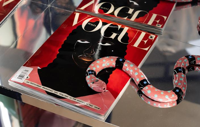 """<div class=""""caption""""> The jewelry case will feature an evolving rotation of semiprecious and one-of-kind pieces. For now, it's home to some of Telsha's beloved objects, like this ceramic snake and Italian Vogue. </div> <cite class=""""credit"""">Photo by Justin Boone</cite>"""