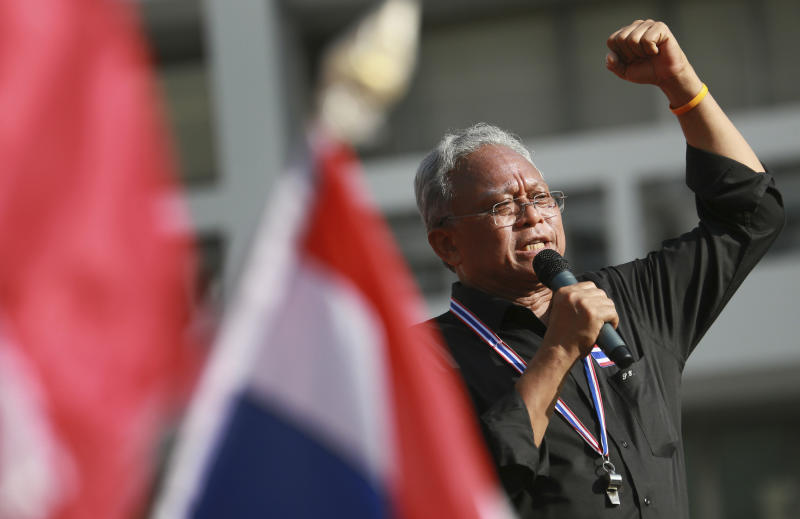 FILE - In this Nov. 27, 2013 file photo, Suthep Thaugsuban, a former deputy premier leading the protest movement, talks to anti-government protesters outside the Government complex in Bangkok, Thailand. Both the protesters on the streets of Bangkok and the Thai government pleading for them to go home say they're on the side of democracy, but that is not what their increasingly dangerous conflict is about. This is a fight about power, and who ought to have it. (AP Photo/Wason Wanichakorn, File)