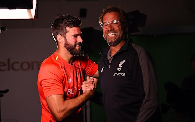 "Jurgen Klopp says Liverpool could not miss the chance to sign one of the world's best goalkeepers after completing the £65 million record transfer of Alisson. Alisson said he made the move to Anfield from Roma to take an 'upward step' in his career. Klopp acknowledged the size of the fee – the most ever paid for a goalkeeper – but felt his club had to act. ""At one point in the last few weeks it came up, the opportunity to sign (one) of the world's best goalkeepers,"" said Klopp. ""Then it's not a long thought, to be honest, it's only that you need to have a little talk with the owners. They were quite excited, so we did it. ""I think it's something we have to do. He has nothing to do with the price, we have nothing to do with the price, it's the market, that's how it is and we will not think a lot about it. ""It shows the value of goalkeepers, of course, in this moment. We are really happy to have him here now. ""He has a lot of experience in the last few years, in Europe and in Rome, he's played an outstandingly high level and he did the same at the World Cup. ""We got him here because of his existing strengths, which is in all goalkeeper departments the highest level."" Alisson to Liverpool: What are his strengths and weaknesses and is he worth £67 million? Liverpool will pay a guaranteed £53.8m, with a further £9m in add-ons based on Premier League and European success. Alisson's first club in Brazil, Internacional, received £2.2m from the deal. ""I'm really happy, it's a dream come true to wear such a prestigious shirt for a club of this size that is used to always winning,"" said Alisson. ""In terms of my life and my career, it's a huge step for me being part of this club and this family. ""You can be certain that I'll give my all."" Liverpool have already moved to recoup some of the cost, agreeing a £12.5m deal with Leicester for Wales international Danny Ward. Liverpool have also guaranteed 20 per cent of any future sale of the keeper. Ward has left Liverpool to chase first team football while Karius will likely end up a backup to Alisson Credit: GETTY IMAGES Leicester's move for Ward means Kasper Schmeichel is facing an uncertain future. The club have stressed Ward's anticipated arrival is not to replace the Dane. However, Claude Puel is understood to have clashed with Schmeichel towards the end of last season and Ward could come in as Leicester's No 1. Leicester expect interest in Schmeichel this summer but are under no pressure to sell after the £60m departure of Riyad Mahrez to Manchester City. Ward was pulled out of Liverpool's friendly against Blackburn on Thursday - where he was set to start - as a move to the King Power Stadium edges closer. Meanwhile, Klopp has revealed he had to talk Jordan Henderson into taking a full summer holiday after the Liverpool captain asked to report back to training early. Henderson has three weeks off following the World Cup, which means he is not due back to work until August 5. That means he has been effectively ruled out of the opening weekend fixture with West Ham as Klopp wants his players to complete a full pre-season. Trent Alexander-Arnold may be given permission to return a week earlier, partly due to the fact he did not play much in Russia, but also because of his age making fatigue less of a concern in the season ahead. Trent Alexander-Arnold hardly featured for England and should have an earlier start for LIverpool than Henderson Credit: PA But Klopp insisted on Henderson having a break. ""It was a hard fight to convince him that he needed a holiday,"" said Klopp. ""I knew it would happen. On the phone I said 'crazy'. Jordan needs a holiday so that means August 5 he will be back. Dejan (Lovren) had a party in Croatia and played a day later so he will be back on August 6. That would mean five days training after three weeks holiday. ""I hope we are in a situation where we don't need to think about using these two (against West Ham). ""With Trent I have a special agreement. He wanted to be in earlier as well. As he's very young I said, 'Okay, have two weeks holiday and then we'll speak and see'. If you asked Trent he would be good to join us in two weeks. But I'm not sure I will do that. I want to have them desperately but the season is really long. It will be difficult to involve them against West Ham but I don't want to make that line up today."""