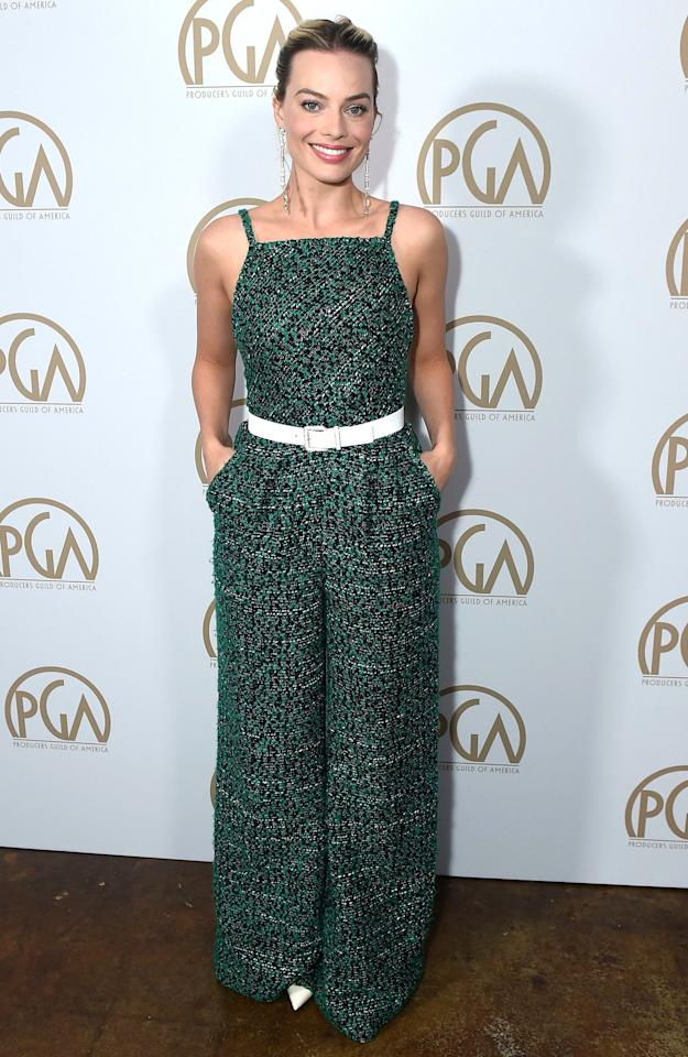 in a green tweed wide-leg Chanel Couture jumpsuit worn with a white belt and matching white pointy-toe pumps at the Producers Guild Awards in L.A.