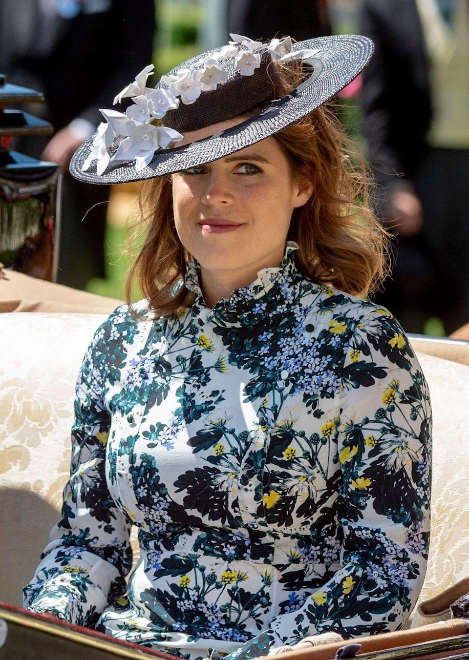 <p>Eugenie picked a flowery blue dress with pops of yellow at Ascot Racecourse in June 2018. </p>