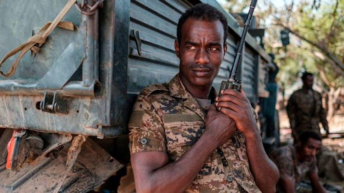 An Ethiopian soldier stands with a walkie talkie in his hand at the 5th Battalion of the Northern Command of the Ethiopian Army in Dansha, Ethiopia, on November 25, 2020