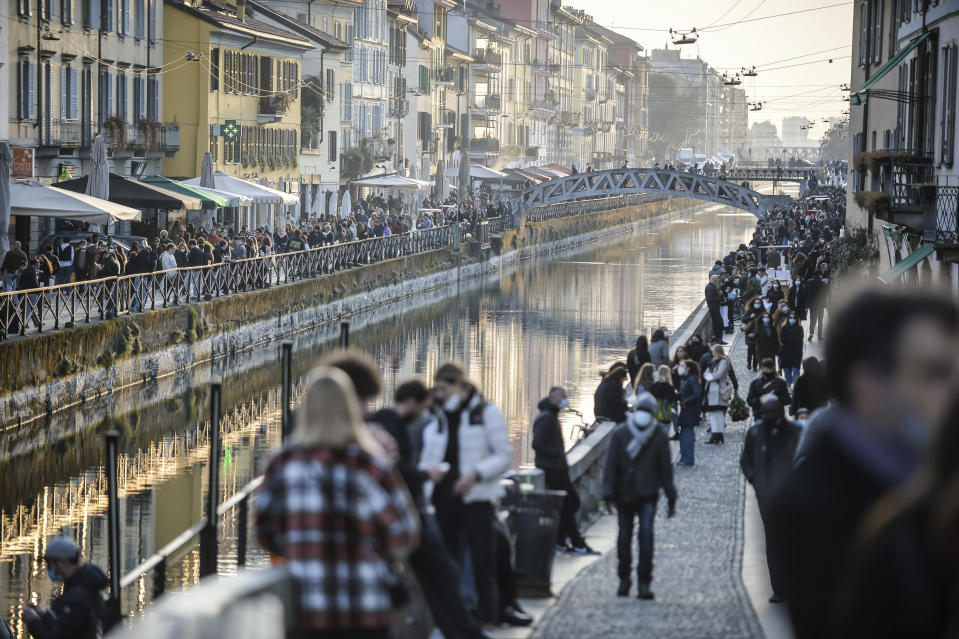 "People stroll in the Navigli popular area Milan, Italy, Saturday, March 13, 2021. From Monday most of Northern Italy will become ""red zone"" with stricter rules aimed at curbing the spread of Covid-19, which is skyrocketing due to the variants. (Claudio Furlan/LaPresse via AP)"