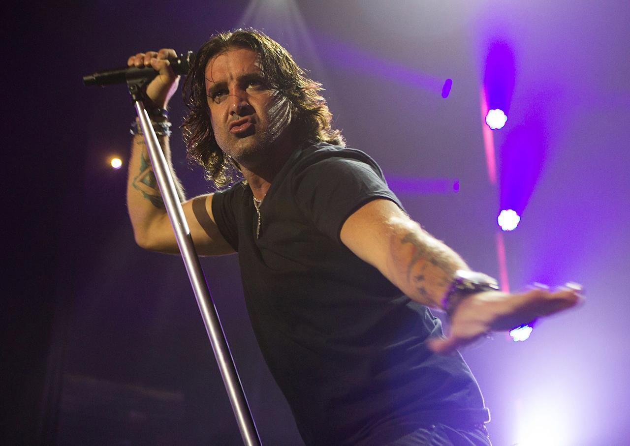 Scott Stapp of Creed performs on stage at the Fox Theater on May 13, 2012 in Pomona, California.  (Photo by Paul A. Hebert/Getty Images)