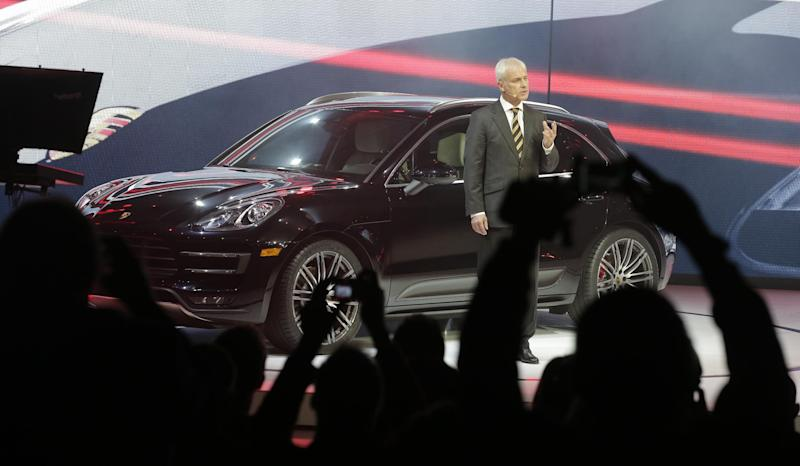Matthias Müller, President of the Executive Board, Porsche AG introduces the new Porsche Macan Turbo at the Los Angeles Auto Show in Los Angeles, Tuesday, Nov. 19, 2013. (AP Photo/Chris Carlson)