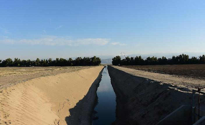 Water levels have dropped significantly in irrigation tunnels near Bakersfield, forcing farmers to seek alternative sources of water (AFP Photo/Frederic J. Brown)
