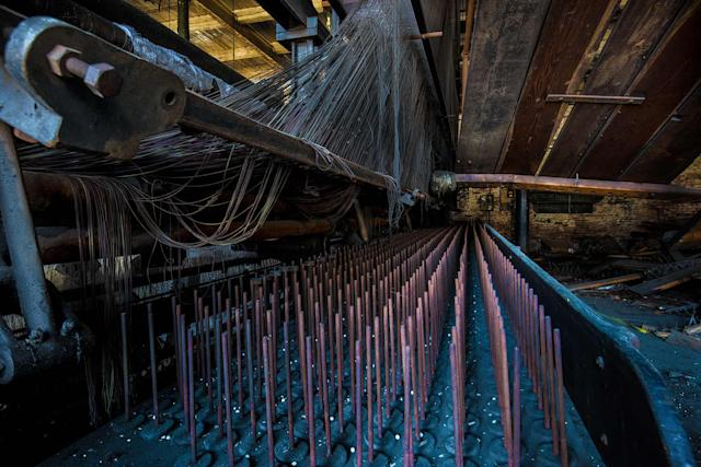 <p>One of her favorite spots is a factory where a loom still remains as it would have been during its operational years, due to the site's quick closure. (Photo: Shelley Koon/Caters News) </p>