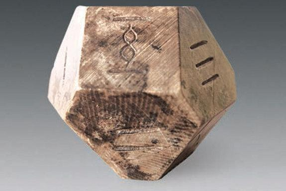 """Archaeologists think this 14-face die was used to play a game called """"bo"""" that hasn't been played in 1,500 years."""