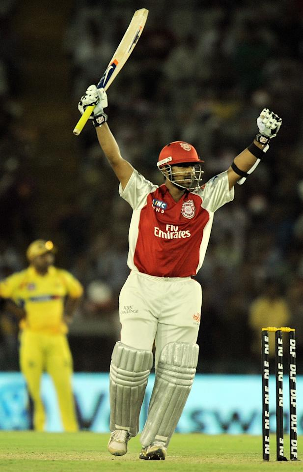 RESTRICTED TO EDITORIAL USE. MOBILE USE WITHIN NEWS PACKAGEKings XI Punjab batsman Paul Valthaty celebrates after scoring a century (100 runs) during the IPL Twenty20 match between Chennai Superkings and Kings XI Punjab at the Punjab Cricket Association (PCA) stadium in Mohali on April 13, 2011.  AFP PHOTO/ MANAN VATSYAYANA (Photo credit should read MANAN VATSYAYANA/AFP/Getty Images)