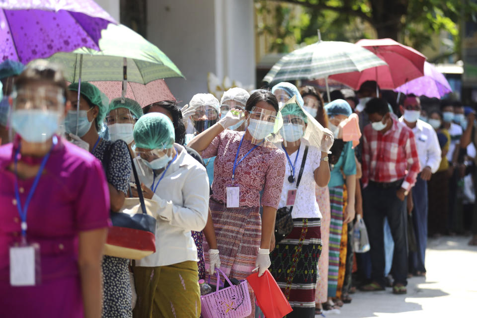 In this Sunday, Nov. 8, 2020, file photo, voters wearing protective face masks to help curb the spread of the coronavirus line up to cast their ballots at a polling station near Shwedagon pagoda in Yangon, Myanmar. After Myanmar's military staged a coup Monday, Feb. 1, 2021, leader Aung San Suu Kyi finds herself back under house arrest. But this time, her standoff with the generals comes after she has sorely disappointed many once-staunch supporters in the international community. (AP photo/ Thein Zaw, File)