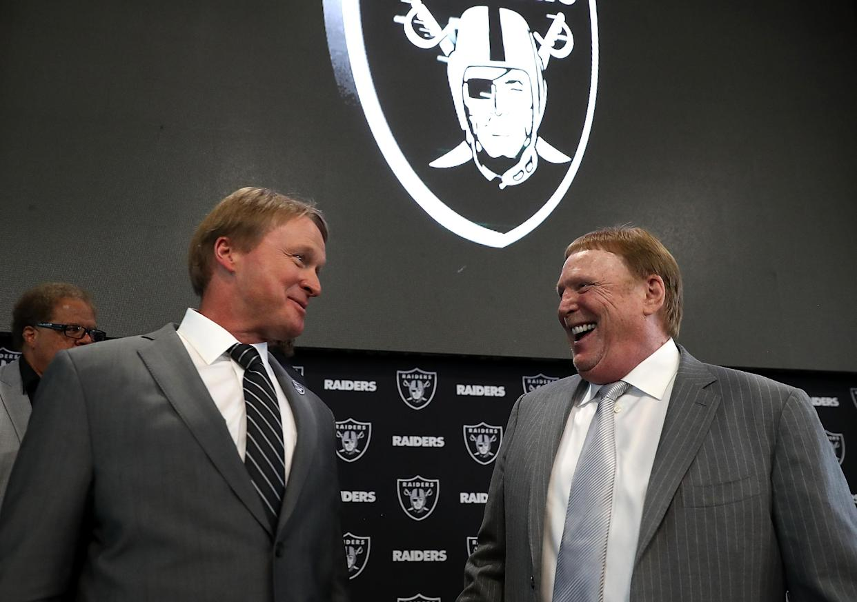 ALAMEDA, CA - JANUARY 09:  Oakland Raiders new head coach Jon Gruden (L) talks with Raiders owner Mark Davis during a news conference at Oakland Raiders headquarters on January 9, 2018 in Alameda, California. Jon Gruden has returned to the Oakland Raiders after leaving the team in 2001.  (Photo by Justin Sullivan/Getty Images)