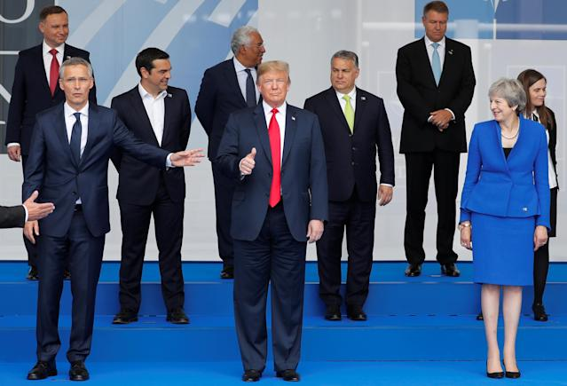 <p>President Trump gestures as NATO leaders pose for a group photo at the start of the NATO summit in Brussels on July 11, 2018. (Photo: Yves Herman/Reuters) </p>