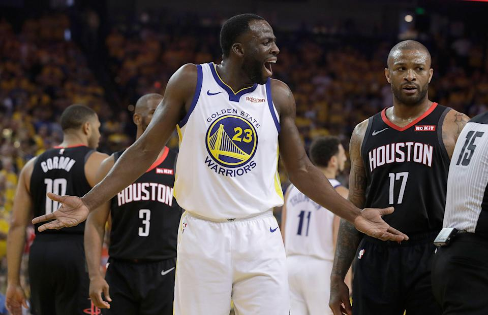 Golden State Warriors forward Draymond Green (23) gestures toward referee Zach Zarba next to Houston Rockets forward PJ Tucker (17) during the first half of Game 1 of a second-round NBA basketball playoff series in Oakland, Calif., Sunday, April 28, 2019. (AP Photo/Jeff Chiu)