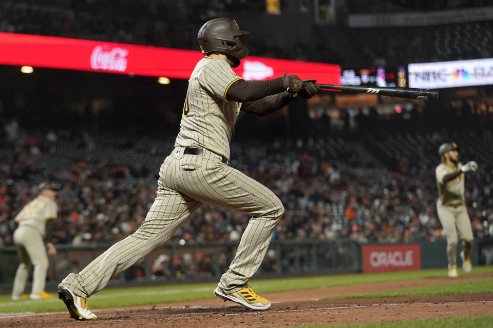 San Diego Padres' Eric Hosmer hits a two-run single against the San Francisco Giants during the second inning of a baseball game in San Francisco, Wednesday, Sept. 15, 2021. (AP Photo/Jeff Chiu)