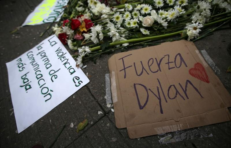 Signs lie in the street where Dilan Cruz was injured, allegedly by a tear gas canister fired by riot police during the national strike on the previous day, in Bogota