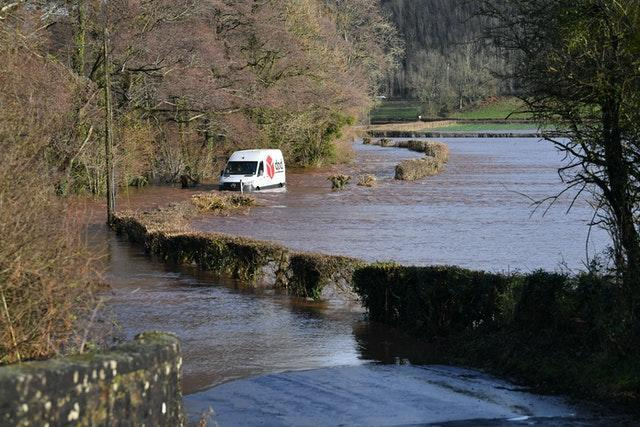 A DPD delivery van was stranded in flood water in Newbridge on Usk