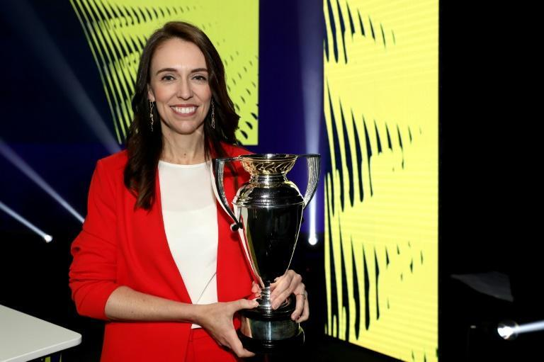 New Zealand Prime Minister Jacinda Ardern poses with the Women's Rugby World Cup during the 2021 draw event in Auckland