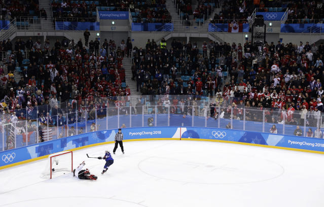 Jocelyne Lamoureux-Davidson (17), of the United States, scores the winning shot during a shootout against goalie Shannon Szabados (1), of Canada, in the women's gold medal hockey game at the 2018 Winter Olympics in Gangneung, South Korea, Thursday, Feb. 22, 2018. (AP Photo/Matt Slocum)