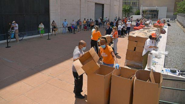 PHOTO: New Yorkers in need receive free produce, dry goods, and meat at a Food Bank For New York City distribution event at Lincoln Center on July 29, 2020 in New York City. (Michael Loccisano/Getty Images)