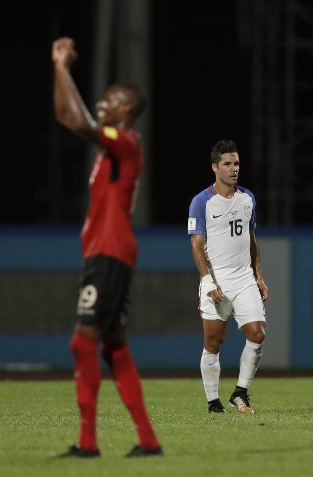 "<a class=""link rapid-noclick-resp"" href=""/soccer/players/benny-feilhaber/"" data-ylk=""slk:Benny Feilhaber"">Benny Feilhaber</a>, right, walks off the field after the U.S. lost to Trinidad and Tobago in October. (AP)"