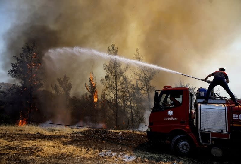 FILE PHOTO: A firefighter tries to extinguish a wildfire near Marmaris, Turkey, August 1,