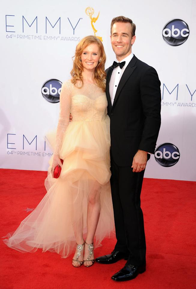 James Van Der Beek (R) and wife Kimberly Van Der Beek arrive at the 64th Primetime Emmy Awards at the Nokia Theatre in Los Angeles on September 23, 2012.